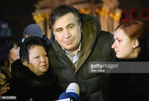 Former Georgian president Mikheil Saakashvili speaks to the media as he attends an evening ceremony to commemorate victims of the Maidan uprising one...