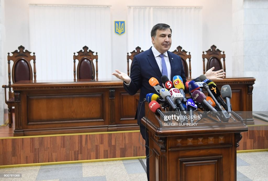 Former Georgian president Mikheil Saakashvili speaks to the media prior to the start of his appeal hearing at a courthouse in Kiev on January 3, 2018. The court, which was to consider the appeal of the prosecutor's office against the decision of the Kiev district court to release Saakashvili from custody, postponed the hearing to January 11, 2018. / AFP PHOTO / Sergei SUPINSKY