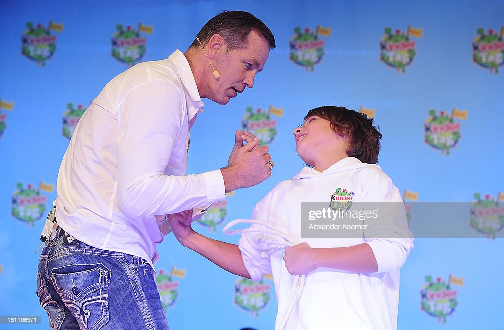 Former German Boxer Henry Maske performs together with the ten year-old Leon a boxing performance during a Ferrero kinderTag 2013 event at Heidepark on September 19, 2013 in Soltau, Germany.