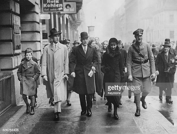 Former German Chancellor Franz von Papen with his wife and son, on their way to the polling station to vote with the Reichs cabinet, Germany, March...