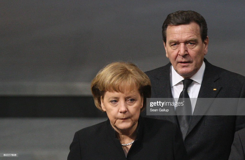 Former German Chancellor Gerhard Schroeder and current Chancellor Angela Merkel arrive at the Bundestag to commemorate former Bundestag President Annemarie Renger on March 13, 2008 in Berlin, Germany. Renger died on March 3.