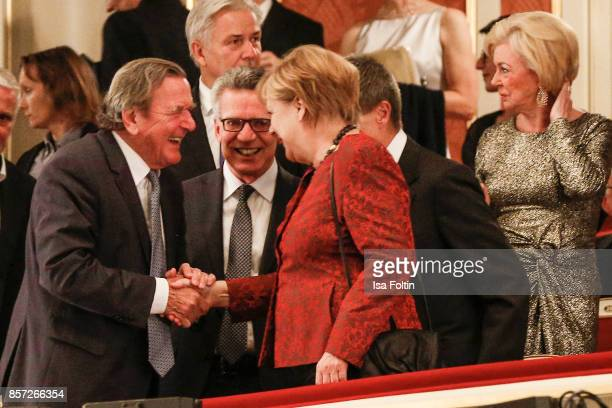 Former German chancellor Gerhard Schroeder and German chancellor Angela Merkel during the ReOpening of the Staatsoper Unter den Linden on October 3...