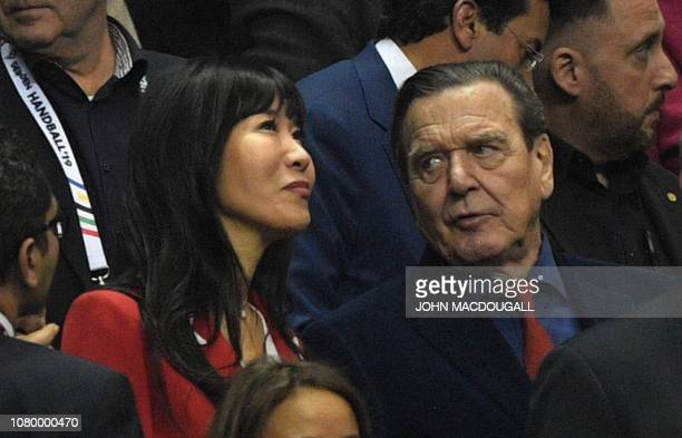 Former German chancellor Gerhard Schroeder and his South Korean wife Kim SoYeon Schroeder attend the opening ceremony of the IHF Men's World...
