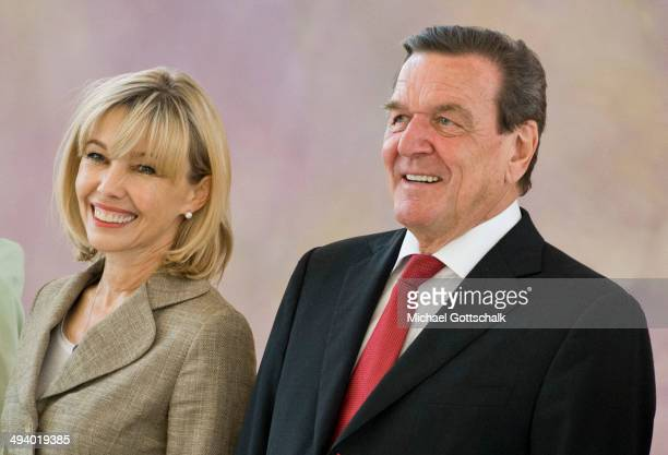 Former German chancellor Gerhard Schroeder and his wife Doris SchroederKoepf arrive for a reception in Bellevue Castle on the occasion of Schroeders...