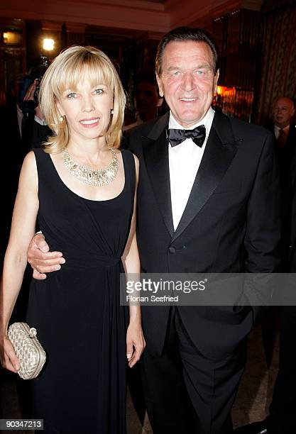 Former German Chancellor Gerhard Schroeder and his wife Doris SchroederKoepf attend the 8 RussianGerman Ball at the Embassy of the Russian Federation...
