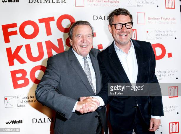 Former german chancellor Gerhard Schroeder and Kai Diekmann attend the 'FotoKunstBoulevard' opening at MartinGropiusBau on May 4 2017 in Berlin...