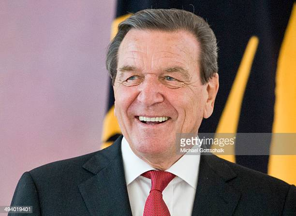 Former German chancellor Gerhard Schroeder arrives for a reception in Bellevue Castle on the occasion of Schroeders 70th birthday on May 27 2014 in...