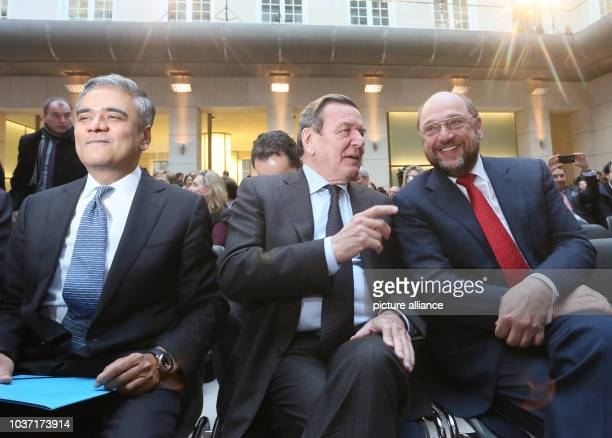 Former German Chancellor Gerhard Schroeder  EU Parliament President Martin Schultz  and CoCEO of Deutsche Bank Ansu Jain sit during the presentation...