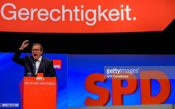 Former German Chancellor Gerhard Schroeder gives a speech during an SPD party congress in Dortmund western Germany on June 25 2017 Martin Schulz...