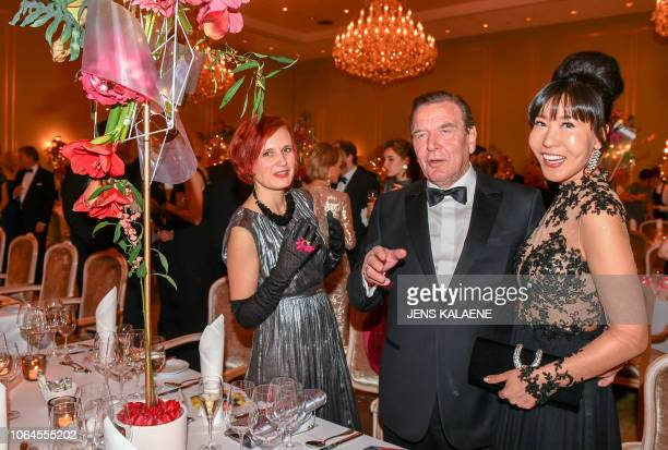 Former German chancellor Gerhard Schroeder , his South Korean wife Kim So-Yeon Schroeder and co-leader of the left-wing Die Linke party Katja Kipping...
