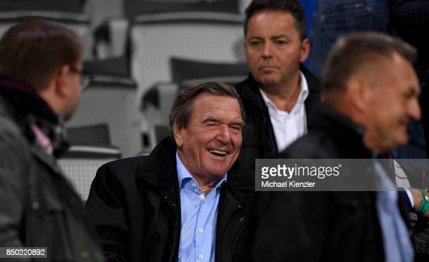 Former German Chancellor Gerhard Schroeder looks on prior to the Bundesliga match between Sport Club Freiburg and Hannover 96 at SchwarzwaldStadion...