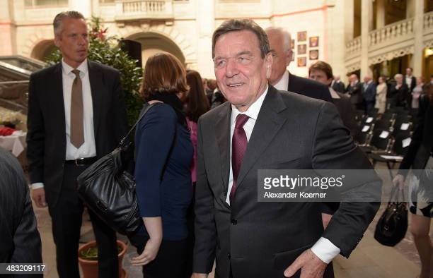 Former German Chancellor Gerhard Schroeder mingles with guests at a reception to celebrate his 70th birthday at City Hall on April 7 2014 in Hanover...