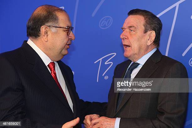 Former German Chancellor Gerhard Schroeder talks to Alisher Usmanov President of the International Fencing Federation during the IOC President Thomas...