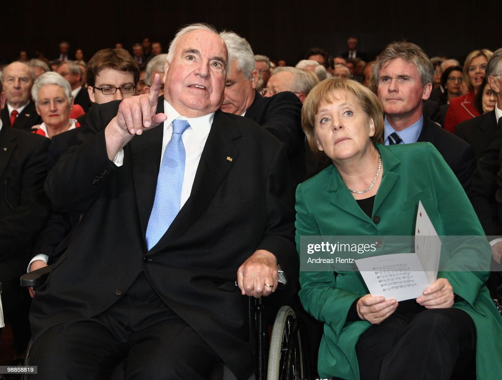 Former German Chancellor Helmut Kohl and German Chancellor Angela Merkel gesture during an official birthday reception to former German Chancellor Helmut Kohl at the Pfalzbau on May 5, 2010 in Ludwigshafen, Germany. Kohl celebrated his 80th birthday on April 3, 2010.