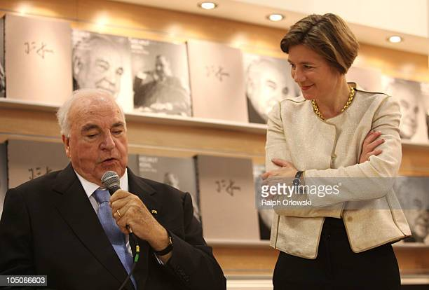 Former German Chancellor Helmut Kohl and his wife Maike KohlRichter watch a photobook of Kohl at the booth of Collection Rolf Heyne during the...
