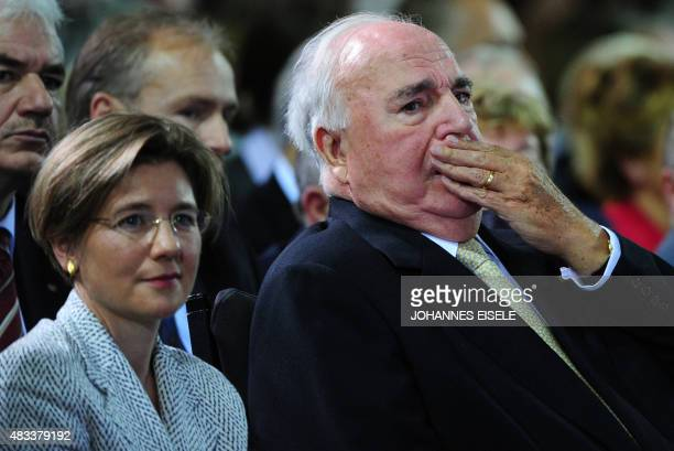 Former German Chancellor Helmut Kohl and his wife Maike Richter attend a celebration ceremony staged by the Christian Democrats Party for the 20th...