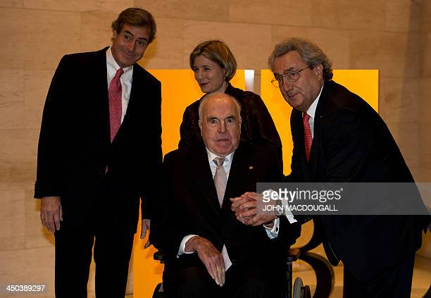 Former German chancellor Helmut Kohl and his wife Maike Richter poses for photographers with Dieter Hundt outgoing President of the Confederation of...