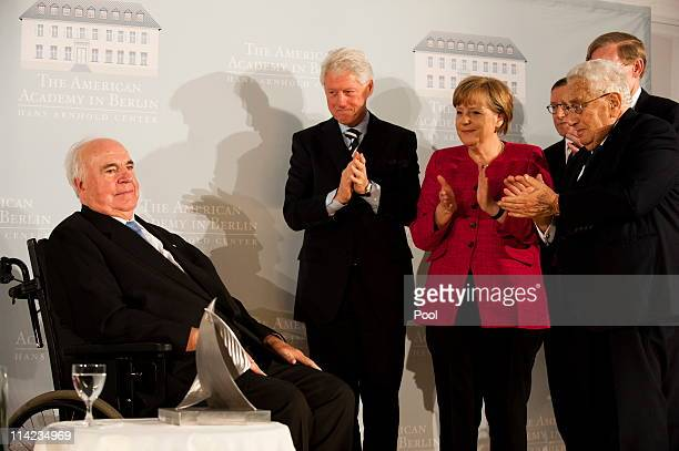 Former German Chancellor Helmut Kohl gets applause by former US President Bill Clinton current German Chancellor Angela Merkel and former US...
