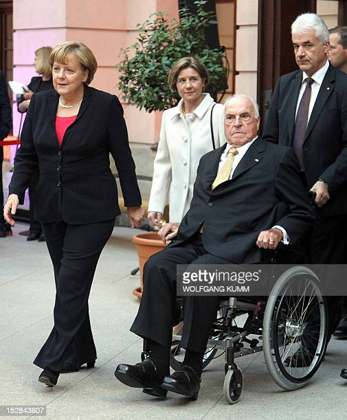Former German Chancellor Helmut Kohl his wife Maike RichterKohl and German Chancellor Angela Merkel arrive at the German Historical Museum in Berlin...