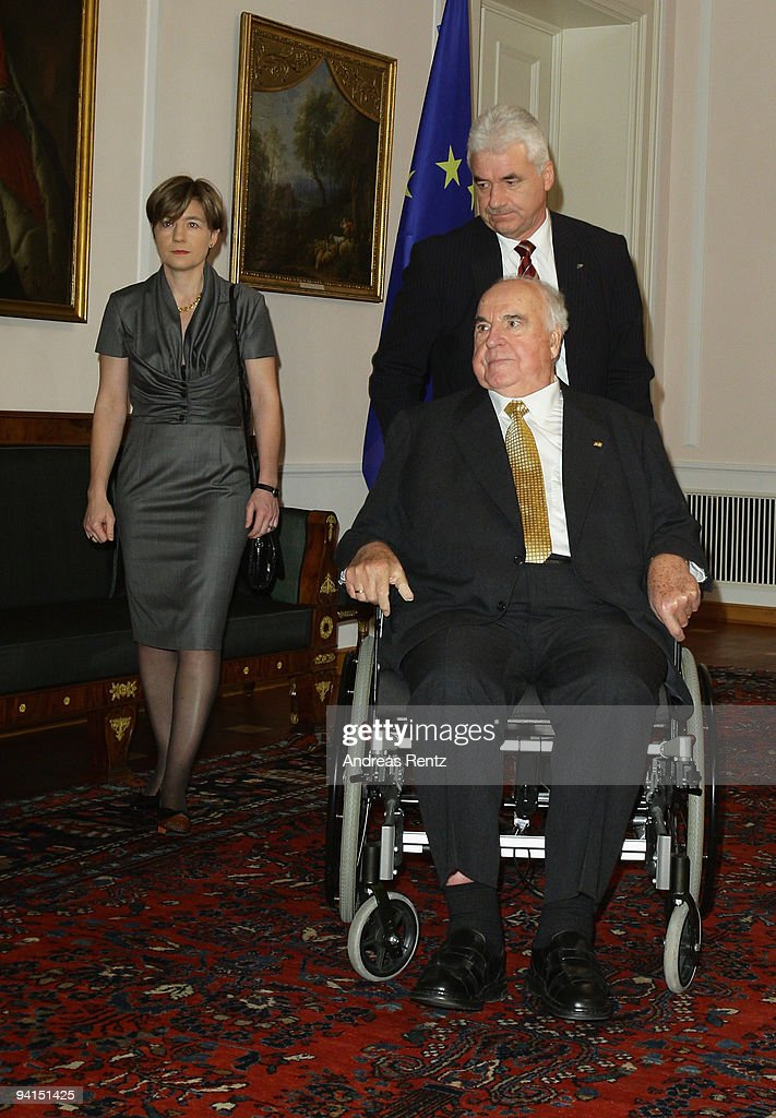 Former German Chancellor Helmut Kohl, is pushed by an assistant, and his wife Maike Richter-Kohl attend a private dinner at Bellevue Pallace on December 8, 2009 in Berlin, Germany. German President Horst Koehler honored Kohl for the lifework of the former German chancellor. Kohl will celebrate his 80th birthday on April 3, 2010.