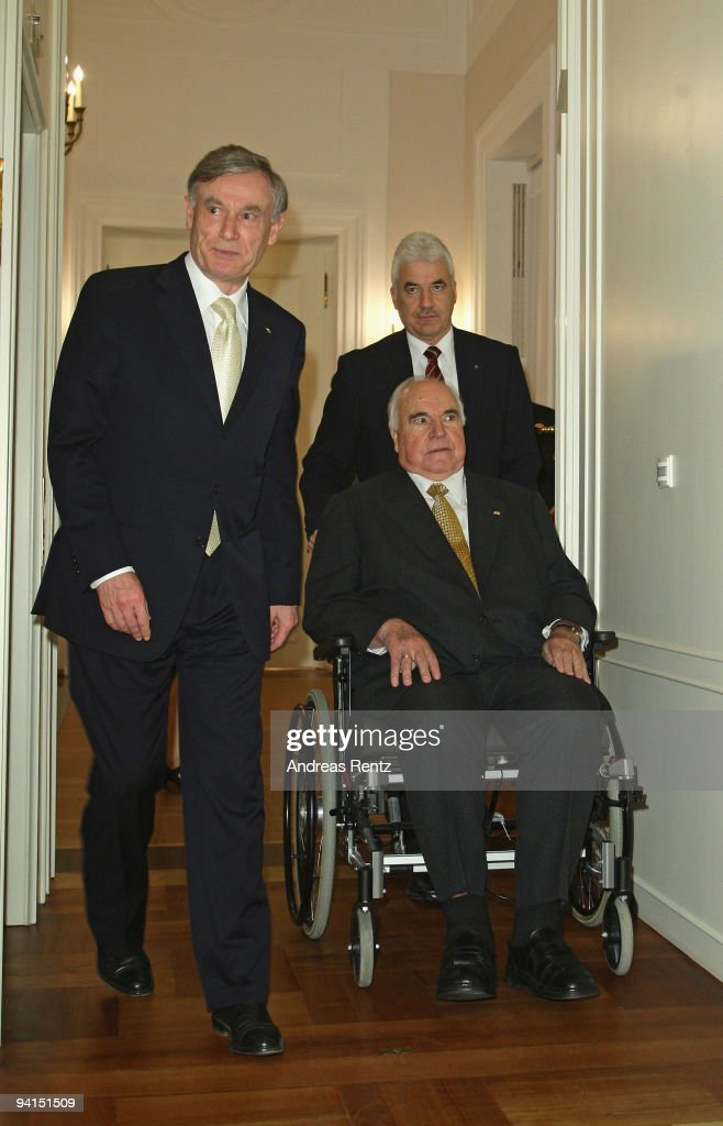 Former German Chancellor Helmut Kohl (R), is pushed by an assistant, and German President Horst Koehler (L) arrive for a private dinner at Bellevue Pallace on December 8, 2009 in Berlin, Germany. President Koehler honored Kohl for the lifework of the former German chancellor. Kohl will celebrate his 80th birthday on April 3, 2010.