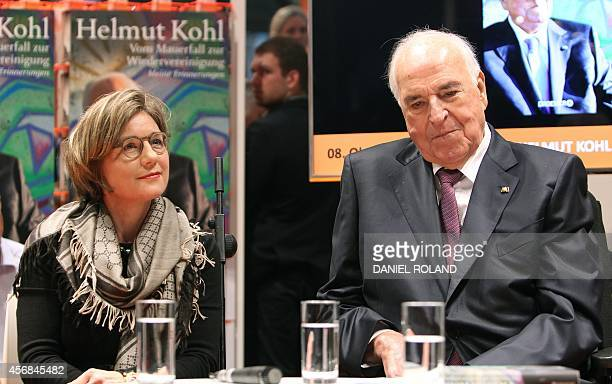 Former German Chancellor Helmut Kohl sits next to his wife Maike Kohl-Richter as he presents a new edition of his memoirs at the opening day of the...