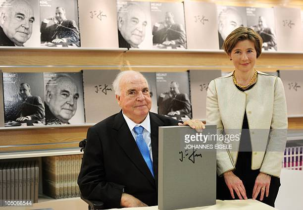 Former German Chancellor Helmut Kohl sits next to his wife Maike RichterKohl at the stand where a photo book about him is presented at the book fair...