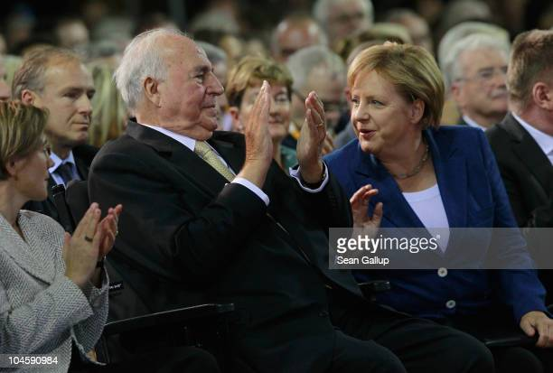 Former German Chancellor Helmut Kohl whose initiatives made German reunification in 1990 possible and current German Chancellor Angela Merkel attend...