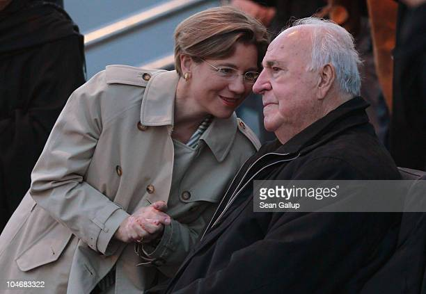Former German Chancellor Helmut Kohl whose initiatives made German reunification in 1990 possible chats with his wife Maike KohlRichter in front of...