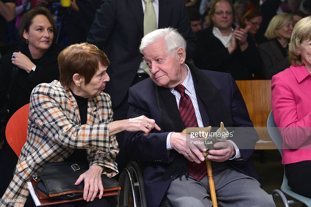 Former German Chancellor Helmut Schmidt and his partner Ruth Loah hold a fluffy toy Kiwi bird at a ceremony at the Kirchdorf/Wilhelmsburg Gymnasium high school on the day the school officially celebrated its renaming to Helmut Schmidt Gymnasium on November 5, 2012 in Hamburg, Germany. Schmidt was German chancellor from 1974 to 1982 and currently lives in Hamburg. The Kiwi was the mascot of the school and nicknamed KiWi from its location Kirchdorf/Wilhelmsburg.