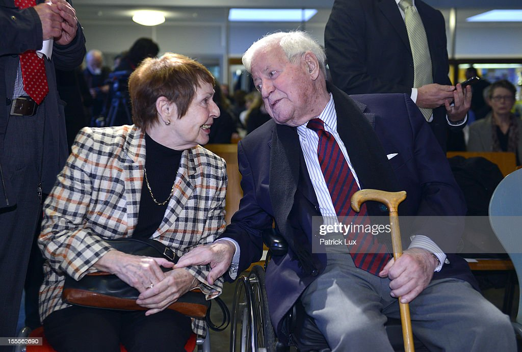 Former German Chancellor Helmut Schmidt and his partner Ruth Loah attend a ceremony at the Kirchdorf/Wilhelmsburg Gymnasium high school on the day the school officially celebrated its renaming to Helmut Schmidt Gymnasium on November 5, 2012 in Hamburg, Germany. Schmidt was German chancellor from 1974 to 1982 and currently lives in Hamburg.