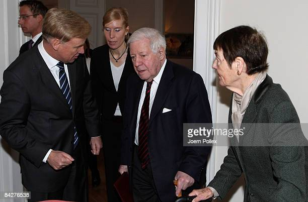 Former German Chancellor Helmut Schmidt and his wife Loki Schmidt talk to Hamburg Mayor Ole von Beust prior to the lunch to celebrate the 90th...