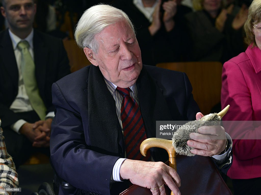 Former German Chancellor Helmut Schmidt holds a fluffy toy Kiwi bird at a ceremony at the Kirchdorf/Wilhelmsburg Gymnasium high school on the day the school officially celebrated its renaming to Helmut Schmidt Gymnasium on November 5, 2012 in Hamburg, Germany. Schmidt was German chancellor from 1974 to 1982 and currently lives in Hamburg. The Kiwi was the mascot of the school and nicknamed KiWi from its location Kirchdorf/Wilhelmsburg.