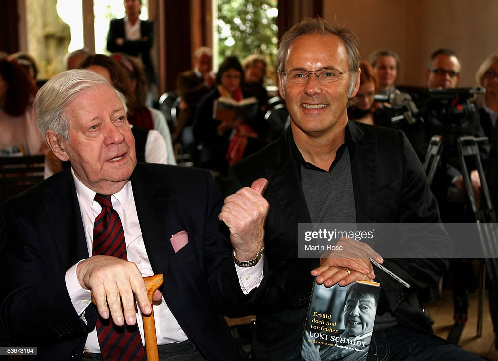 Former German chancellor Helmut Schmidt (L) speaks to Reinhold Beckmann (R) during the book presentation of his wife Loki Schmidt at the Heinrich Heine House on November 13, 2008 in Hamburg, Germany.