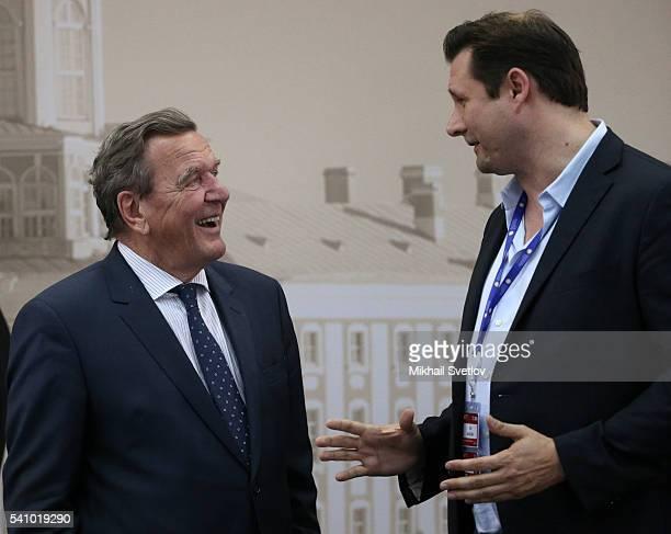 Former German Chancellor Nord Stream Chairman of board Gerhard Schroder listern to JumpStartFund Ceo Dirk Ahlborn during the Saint Petersburg...