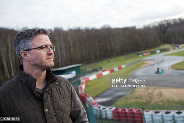 Former German F1 driver Ralf Schumacher looks on at the karting circuit in Kerpen located 30 kilometres from Cologne in western Germany on January 10...