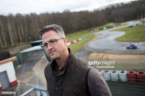 Former German F1 driver, Ralf Schumacher, poses on January 10, 2018 at the karting circuit in Kerpen, located 30 kilometres from Cologne in western...