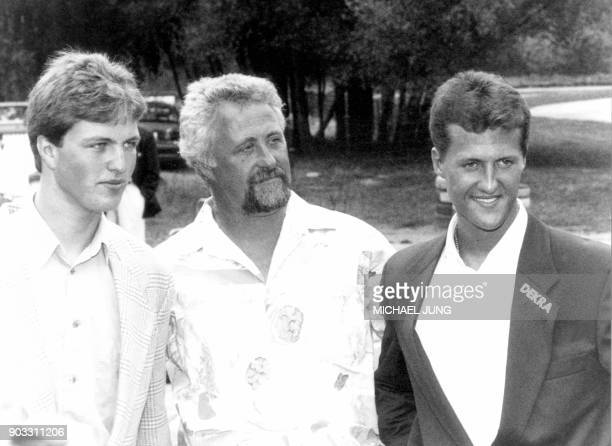 Former German F1 drivers Michael Schumacher and his brother Ralf Schumacher pose with their father Rolf Schumacher on July 19 1993 at the karting...