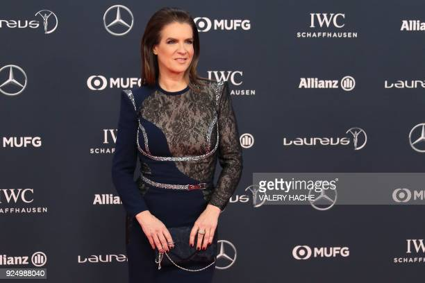 Former German figure skater and Laureus academy member Katarina Witt poses on the red carpet before the 2018 Laureus World Sports Awards ceremony at...