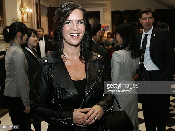 Former German figure skater Katarina Witt smiles at a cocktail party to promote Munich as candidate city for Winter Olympics 2018 on November 25,...