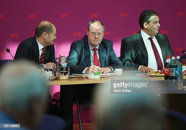 Former German Finance Minister Peer Steinbrueck Hamburg Mayor Olaf Scholz and German Social Democrats Chairman Sigmar Gabriel arrive for a meeting of...