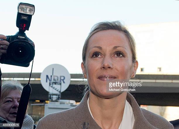 Former German First Lady Bettina Wulff arrives at the Landgericht Hannover courthouse to testify in the case of her estranged husband, former German...