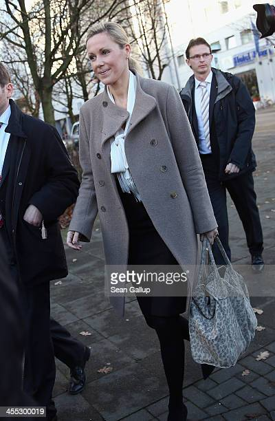 Former German First Lady Bettina Wulff arrives to testify in the trial of her estranged husband former German President Christian Wulff at the...