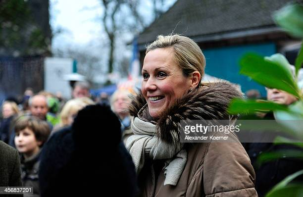 Former German First Lady Bettina Wulff attends the Christmas Fair at Hemme Milchhof where she reads reads her favourite Christmas story 'Pelle Zieht...
