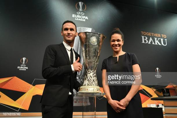 Former German football Celia Sasic and Former Portuguese football player Ricardo Carvalho pose with the cup after the draw for the round of 32 of the...