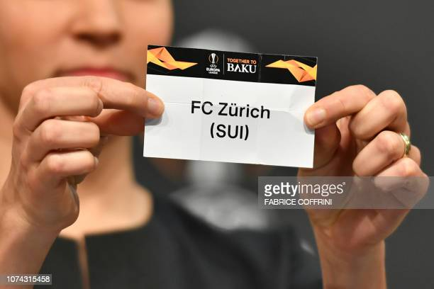 Former German football Celia Sasic shows the slip of FC Zurich during the draw for the round of 32 of the UEFA Europa League football tournament at...