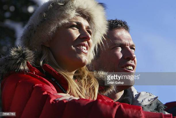 Former German football international Lothar Matthaeus and his wife Mariana watch the men's downhill at the Hahnenkamm Ski Races January 24 2004 in...