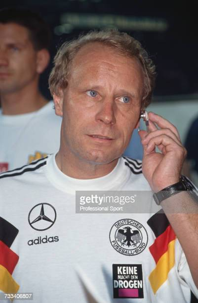 Former German footballer and manager of the Germany national football team Berti Vogts pictured adjusting an earpiece microphone during a 1993 US Cup...