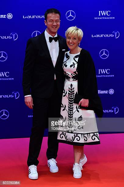 Former German footballer Fredi Bobic and his wife Britta arrive on the red carpet before the Laureus World Sports 2016 Awards Ceremony in Berlin on...