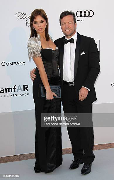 Former German footballer Lothar Matthaus and model Kristina Liliana attends the amfAR Cinema Against AIDS 2010 at the Hotel du Cap during the 63rd...